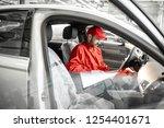 auto mechanic in red uniform... | Shutterstock . vector #1254401671