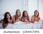 look at the camera. joyful... | Shutterstock . vector #1254417391