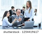 business team discussing with... | Shutterstock . vector #1254419617