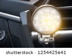 close up headlights 4wd | Shutterstock . vector #1254425641