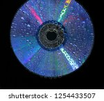 Cd Disk With Drops On The Hook...