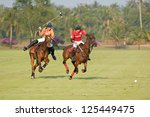 Small photo of PATTAYA - JANUARY 19: Players fighting for the ball during the final between Thai Polo wearing orange and Axus wearing red shirts at Thai Polo Open on January 19, 2013 in Pattaya, Thailand.