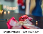young woman is packing presents.... | Shutterstock . vector #1254524524
