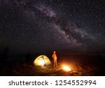 night camping in mountains.... | Shutterstock . vector #1254552994