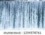 mountain river flowing... | Shutterstock . vector #1254578761