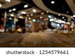 empty dark wooden table in... | Shutterstock . vector #1254579661