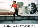 female athlete doing drag... | Shutterstock . vector #1254582181