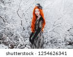 heavy snowfall. girl with long... | Shutterstock . vector #1254626341