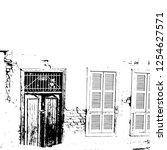 wooden door in the old town...   Shutterstock .eps vector #1254627571