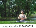 fitness asian woman doing yoga... | Shutterstock . vector #1254636094