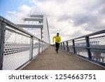 attractive fit man running fast ... | Shutterstock . vector #1254663751