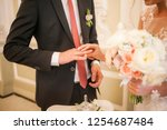 bridegroom and bride exchange... | Shutterstock . vector #1254687484