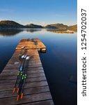 oars for kayaks lie on the dock ... | Shutterstock . vector #1254702037