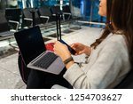woman waiting his flight at... | Shutterstock . vector #1254703627