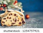 christmas stollen on blue green ... | Shutterstock . vector #1254757921