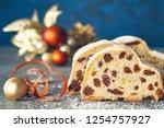 christmas stollen on white blue ... | Shutterstock . vector #1254757927