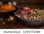 Stock photo traditional new years meal black eyed peas and ham hock with cornbread 1254772384
