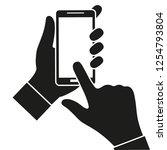 hand holding black smartphone ...   Shutterstock .eps vector #1254793804