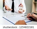 customer writing signing... | Shutterstock . vector #1254822181