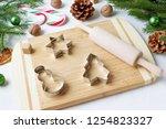 cooking christmas gingerbread. | Shutterstock . vector #1254823327