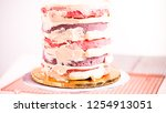 baker frosting pink and purple... | Shutterstock . vector #1254913051