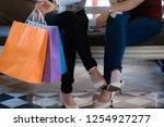 women with high heels and... | Shutterstock . vector #1254927277