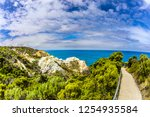 footpath to the ocean on the... | Shutterstock . vector #1254935584