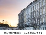 a row of typical townhouses in...   Shutterstock . vector #1255067551