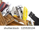 A close-up image of tools on the construction belt over the white background - stock photo