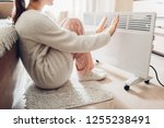 using heater at home in winter. ... | Shutterstock . vector #1255238491
