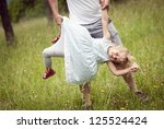happy family is playing... | Shutterstock . vector #125524424