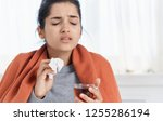 ailing woman with a... | Shutterstock . vector #1255286194