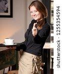 portrait of waitress holding... | Shutterstock . vector #1255354594