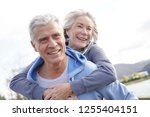 fun loving senior couple... | Shutterstock . vector #1255404151
