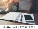 Small photo of Diary, Calendar and agenda for Event Planner to plan timetable, appointment, organization, management on office table. Desktop Calender and coffee place on wooden desk. Calendar Background Concept