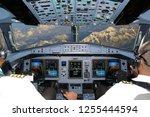 cockpit of civil airplane... | Shutterstock . vector #1255444594