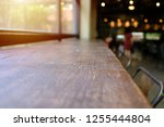 wood table top with blur of... | Shutterstock . vector #1255444804