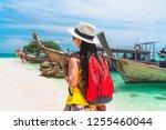 traveler woman in summer dress... | Shutterstock . vector #1255460044