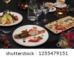 tasty restaurant dishes  cooked ...   Shutterstock . vector #1255479151
