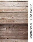 empty wooden shelves in front... | Shutterstock . vector #1255550314
