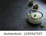 teapot and teacups on black... | Shutterstock . vector #1255567537