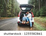 lovely couple sitting in car... | Shutterstock . vector #1255582861