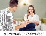 sad handsome man thinking over... | Shutterstock . vector #1255598947