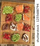 selection of toasts bruschetta... | Shutterstock . vector #1255688794