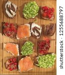 selection of toasts bruschetta... | Shutterstock . vector #1255688797
