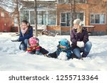family playing with snow in the ... | Shutterstock . vector #1255713364