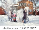 family playing with snow in the ... | Shutterstock . vector #1255713367