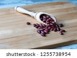 Wooden spoon with beans on rustic background with copy space. Organic food concept.