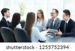 business team holds a workshop... | Shutterstock . vector #1255752394
