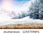 an old wooden table on a...   Shutterstock . vector #1255759891